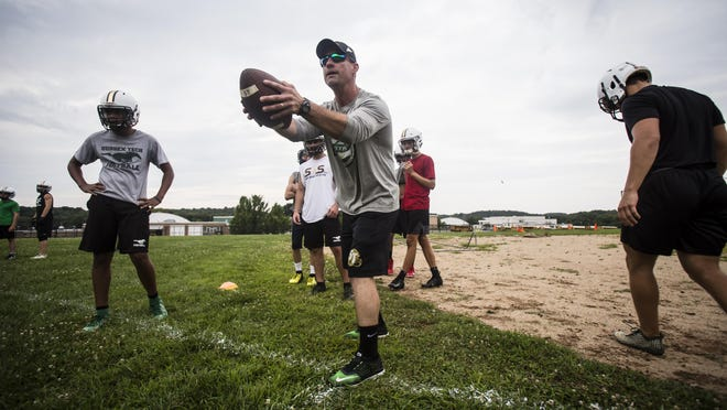 Sussex Tech head football coach Brian Stellingwerf throws passes during practice Aug. 14, 2019, in Sparta.