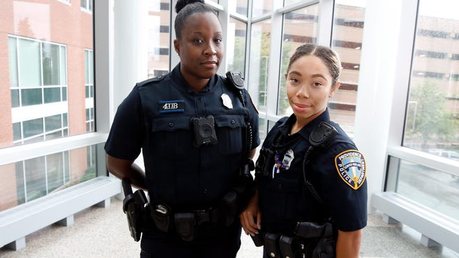 Deanna Johnson and Jan-Delle Johnson (who are unrelated), pose inside the Providence Public Safety Complex. Both said the hostility shown by some protesters toward all police has been difficult for them.