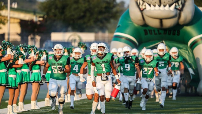 Burnet Bulldogs team enters the field to play against Jarrell Cougars as the first game of the football weekend during the pandemic in Burnet on Friday, August 28, 2020.
