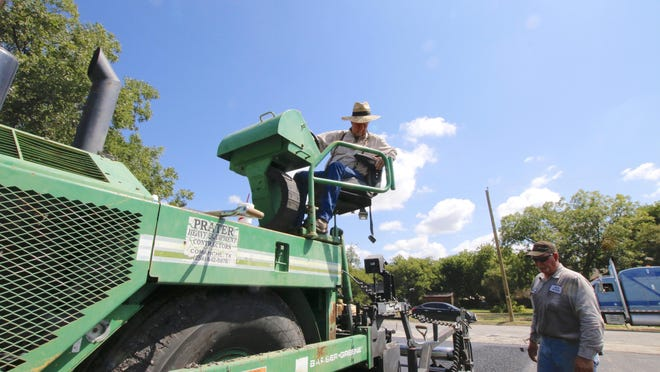 David Bond operates a lay down machine Tuesday as Grider Paving of Early paves the parking lot at Midtown Church, located at Third Street and Avenue K in Brownwood.