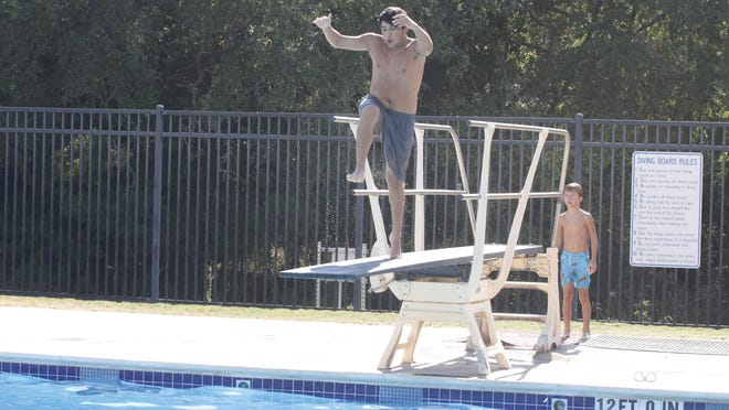 Brownwood High School freshman Mario Lara prepares to do a front flip off the diving board at the Camp Bowie Family Aquatic Center Friday afternoon. The pool is among the facilities supported by the City of Brownwood annual budget.