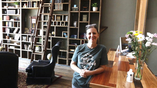 Kim Bruton, who with her husband Brent owns the Intermission Book Shop, is pictured Monday inside the new business, which had a grand opening Saturday.