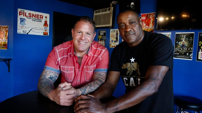 "Boxer Jarrod Tillinghast, left, and Jamie ""JL"" Lee at JL Dana's Sport Lounge in North Providence. The two friends teamed up to make 25 lobster rolls with fries and deliver them to North Providence police to boost morale and help unify the community."