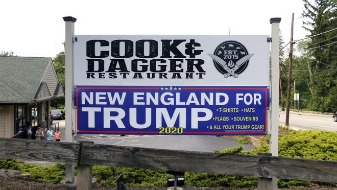"""The Cook and Dagger restaurant in Smithfield says some customers have said they won't return because of the """"New England for Trump 2020"""" sign below theirs -- even though the restaurant has nothing to do with the sign."""