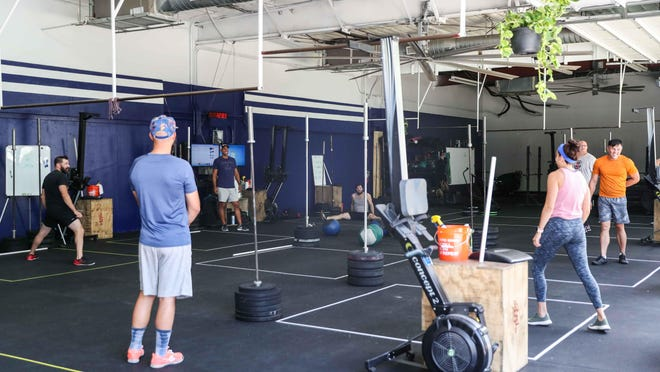 Co-owner Dave Appel leads a training class at SOLA Fitness on South Lamar Boulevard in Austin on Tuesday.  The gym dropped its affiliation with the CrossFit brand over comments made by the company's former CEO..