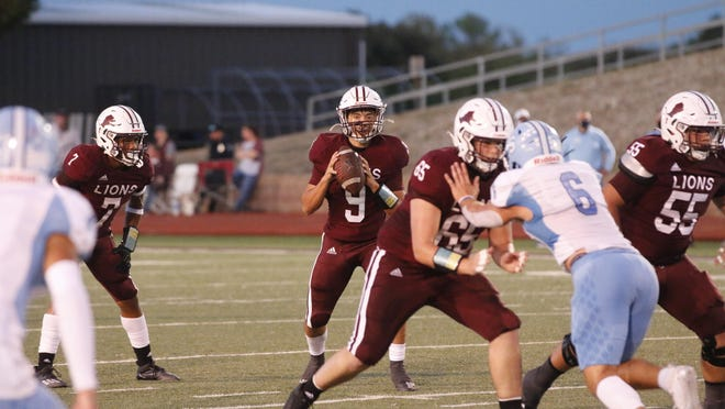 Lions sophomore quarterback Chance Jones prepares to pass in first-quarter action Friday night at Gordon Wood Stadium