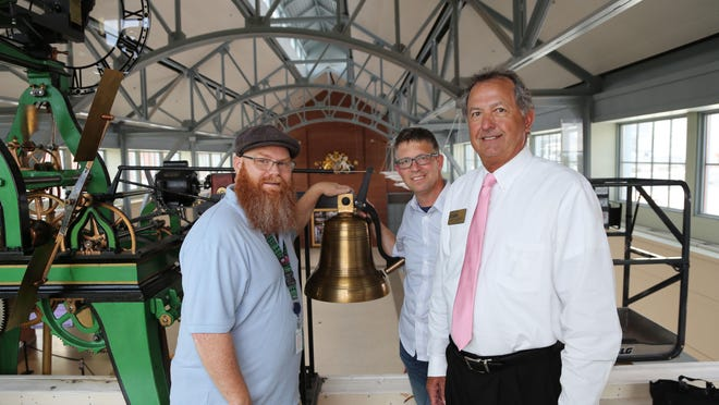 Tryon Palace Multimedia Technician Rob Jones (left), recruited the help of Craven CC instructor Jeff Brown (center) and Dean of Career Programs Ricky Meadows (right) to replace a broken piece of a 1911 mechanical clock, located in the North Carolina History Center.