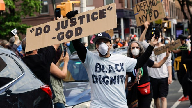 Omar Fernandez takes part in the June 2 Prayerful Protest march for George Floyd in the Brooklyn borough of New York. Floyd died after being restrained by Minneapolis police officers on Memorial Day, May 25.