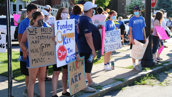 Dozens of people gathered on the common and around City Hall Wednesday, June 17 for a rally in support of the Leominster school system and the more than 100 staff members who received unemployment notices a couple of weeks ago.