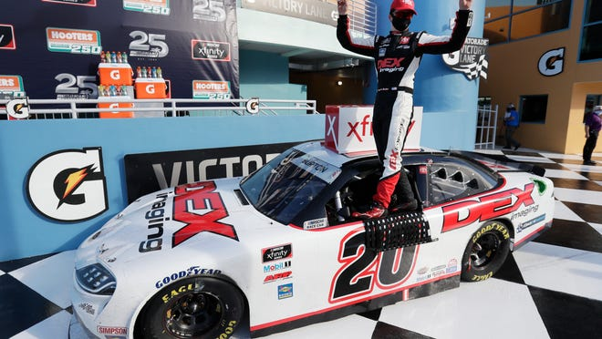 Harrison Burton celebrates after winning a NASCAR Xfinity Series race at Homestead.