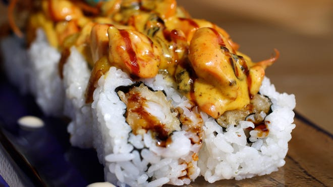 La Pela Roll at El Ninja, a new Domincan-Japanese fusion restaurant on Providence's Broad Street.It's a combination maki of shrimp tempura with cream cheese and guacamole, crowned by a small slice of maduro, sweet plaintains, and covered with a mixed seafood sauce.