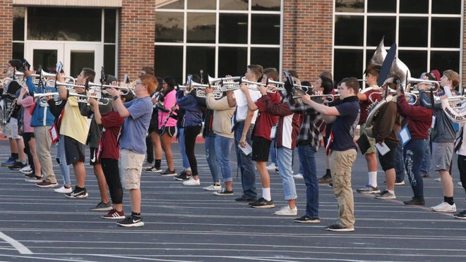 """Members of the 120-member Brownwood High School marching band practice the band's half-time show """"Get Back"""" Thursday morning under the direction of head band director David Lambert. Assistant directors are Leslie Lambert, Megan Yeats, Ethan Yeats and William Massey. Drum majors are Sarah Reeves and Elbi Thaqui. Assistant drum majors are Nick Grace and Victoria Ramos."""