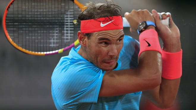 Rafael Nadal plays a shot against Italy's Stefano Travaglia in the third round of the French Open in Paris on Friday.