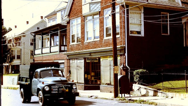 This photo from Ranshaw, Pennsylvania, taken in 1973 shows Greg Zyla's grandfather's store with the Holsum bread logos at 251 Main St. and the family porch on the house to the left at 247 Main St. Our car author stood on that porch until 1958 watching all the cars and trucks pass by. The photo shows one of the many Studebaker coal trucks that drove by back then.
