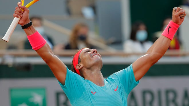 Spain's Rafael Nadal celebrates winning the semifinal match of the French Open tennis tournament against Argentina's Diego Schwartzman in three sets, 6-3, 6-3, 7-6, at the Roland Garros stadium in Paris, France, Friday, Oct. 9, 2020.