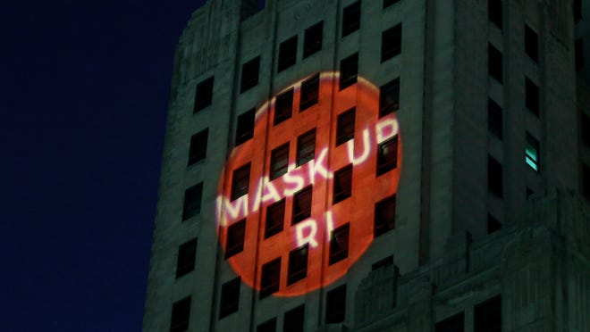 "Providence, RI, April 22, 2020 - StyleWeek, Rhode Island Commerce and Providence Warwick Convention & Visitors Bureau Launch Mask Up RI Wednesday evening with their new Logo projected on the Westminster side of the ""Superman building""."