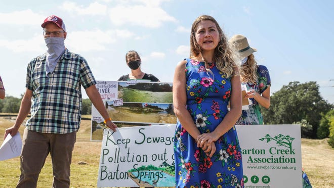 Brian Zabcik, left, the author of a report that found pollutants in treated wastewater across 17 counties in Central Texas, gives a news conference Wednesday in Dripping Springs with Angela Richter, right, and other members of the Save Barton Creek Association.
