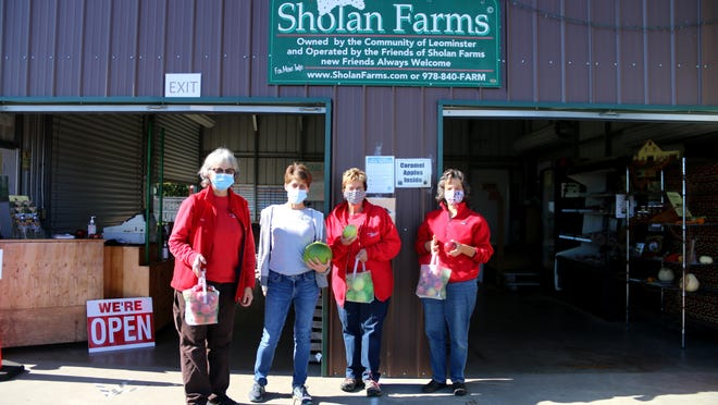 From left, Friends of Sholan Farms volunteers Joanne DiNardo, Nicole Cormier, Karen McNall and Pat Adams outside the farm stand at Sholan Farms.