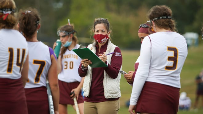 Tiverton field hockey head coach Lauren Tavares checks off items on her clipboard during a break in the Tigers' season-opening 3-1 win over Pilgrim on Saturday. Tavares was named the National Federation of State High Schools Associations Rhode Island Coach of the Year in her sport earlier this month.