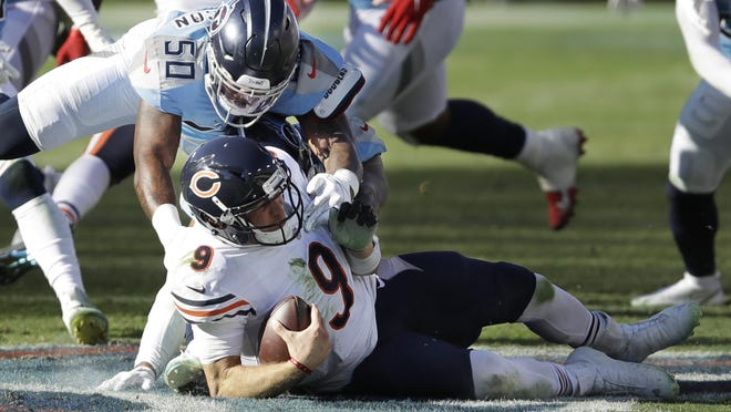 Tennessee Titans linebacker Derick Roberson (50) brings down Chicago Bears quarterback Nick Foles (9) in the second half of a game Sunday in Nashville, Tenn.