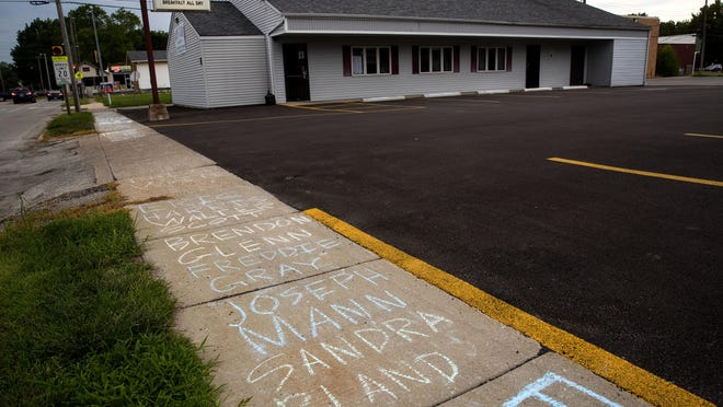 """Protesters chalked the sidewalks outside the D&J's Café, 915 W. Laurel St., with the names of persons killed by police, including George Floyd, Laquan McDonald, Tamir Rice, Breonna Taylor and Eric Garner, after the cafe's owner John Price called Floyd """"a thug"""" and """"a criminal"""" on his personal Facebook account."""