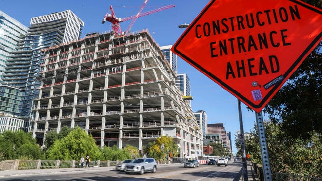 Construction crews work on a new tower in downtown Austin on Monday.  Austin's economy continued to grow in September, but the rate of growth slowed, according to new data from the Federal Reserve Bank of Dallas.
