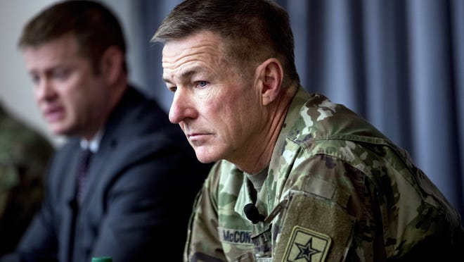 """AP FILE PHOTOSecretary of the Army Ryan McCarthy, left, accompanied by Gen. James McConville, Army chief of staff, speaks at a news conference at Fort Detrick in Frederick, Md., in March. Military suicides have increased by as much as 20% this year compared to the same period last year, and some incidents of violent behavior have spiked also as service members struggle with isolation and other impacts of COVID-19 added to the pressures of war-zone deployments. McConville said there's new attention to giving service members """"the time that they need to come back together and recover."""""""