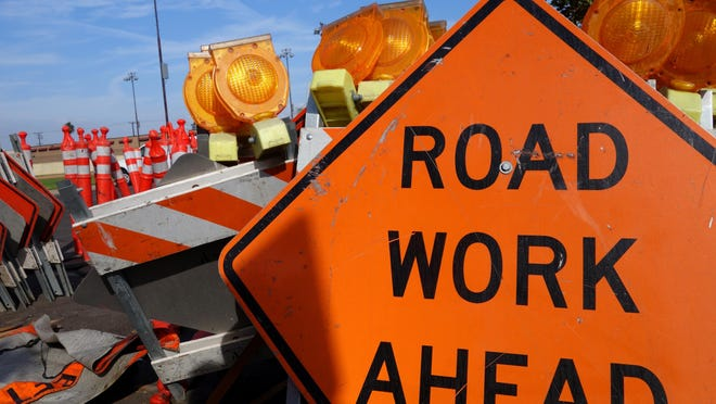 A highway construction worker died Monday after being hit by a car veering to avoid a collision.