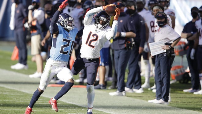 Chicago Bears wide receiver Allen Robinson (12) catches a pass as he is defended by Tennessee Titans cornerback Malcolm Butler (21) in the second half of an NFL football game Sunday, Nov. 8, 2020, in Nashville, Tenn.