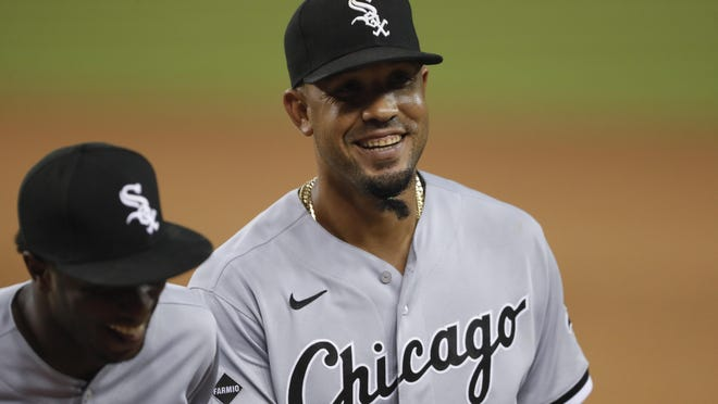 Chicago White Sox first baseman Jose Abreu (79) smiles as he walks to the dugout during a game against the Detroit Tigers at Comerica Park.