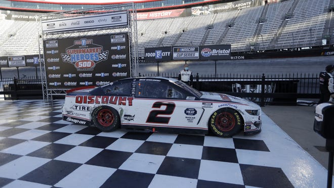 Brad Keselowski (2) pulls up to victory lane after winning a NASCAR Cup Series auto race at Bristol Motor Speedway Sunday, May 31, 2020, in Bristol, Tenn.