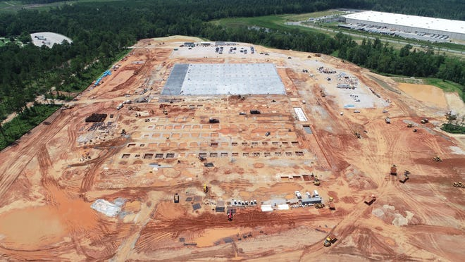 An aerial photo taken in early July of the Amazon fulfillment center in Columbia County's White Oak industrial park shows foundation work in progress. Club Car's 550,000-square-foot distribution center is in the upper right side of the photo.
