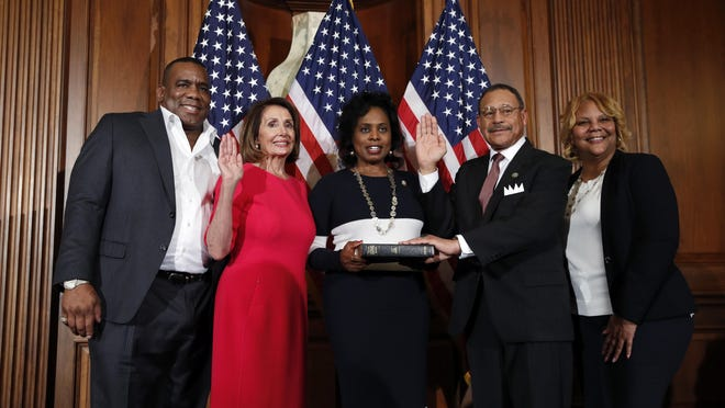 FILE - House Speaker Nancy Pelosi of Calif., left, poses during a ceremonial swearing-in with Rep. Sanford Bishop, D-Ga., second form right, on Capitol Hill, Thursday, Jan. 3, 2019 in Washington, during the opening session of the 116th Congress.