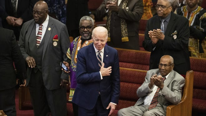 In this Sunday, Feb. 23, 2020, file photo, Democratic presidential candidate and former Vice President Joe Biden acknowledges applause from parishioners as he departs after attending services at the Royal Missionary Baptist Church in North Charleston, S.C. Democrats are betting on Biden's evident comfort with faith as a powerful point of contrast in his battle against President Donald Trump.