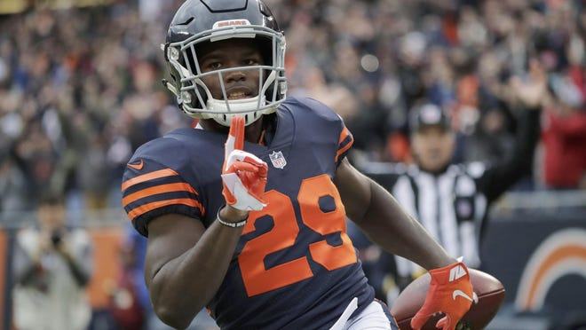 Chicago Bears running back Tarik Cohen (29) celebrates after running to the end zone for a touchdown during the first half of an NFL football game against the New York Jets Sunday, Oct. 28, 2018, in Chicago.