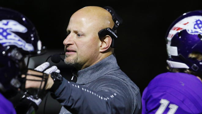 Burlington (Iowa) High School football coach Zach Shay greets players as they return to the sidelines during the first half of their game against Bettendorf High School on Friday Sept. 28, 2018 at Burlington's Bracewell Stadium.