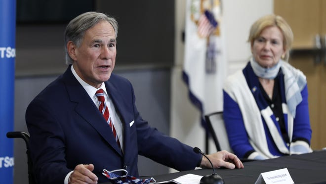 Texas Gov. Greg Abbott responds to a question as Dr. Deborah Birx, White House coronavirus response coordinator, looks on during a June 28 news conference after Vice President Mike Pence met with Abbott and members of his healthcare team regarding COVID-19 at the University of Texas Southwestern Medical Center West Campus in Dallas.