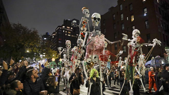 Revelers march during the Greenwich Village Halloween Parade, Thursday, Oct. 31, 2019, in New York.