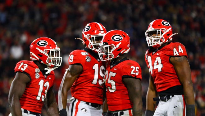 Georgia outside linebacker Azeez Ojulari (13), Georgia outside linebacker Adam Anderson (19), Georgia inside linebacker Quay Walker (25), Georgia linebacker Travon Walker (44) during the Bulldogs' game against Missouri on Dooley Field at Sanford Stadium in Athens, Ga., on Saturday, Nov. 9, 2019.