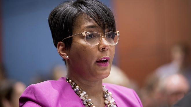 FILE - In this July 17, 2019, file photo, Atlanta Mayor Keisha Lance Bottoms speaks during a Senate Democrats' Special Committee on the Climate Crisis on Capitol Hill in Washington. When the United States erupted in unrest following Martin Luther King Jr.'s assassination in 1968, his hometown of Atlanta was one of the few major cities to maintain relative peace. Mayor Keisha Lance Bottoms invoked that history in a passionate and deeply personal plea for protesters to go home.