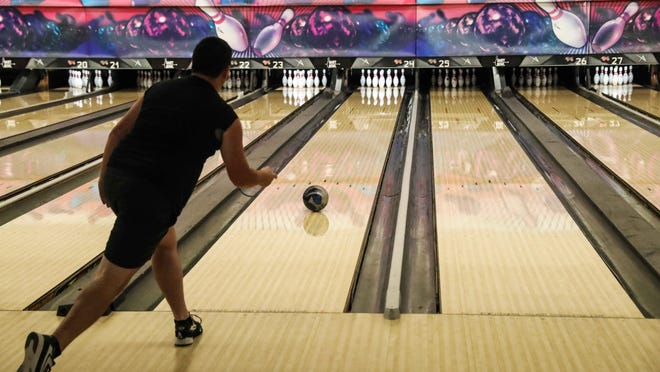 Chris Bogan bowls last week at the Dart Bowl, which closed its doors Friday after 62 years of business.