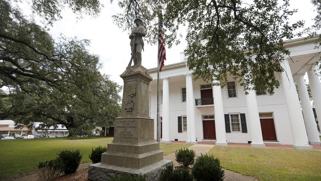 A statue commemorating fallen confederate soldiers stands on front of the East Feliciana Parish Courthouse in Clinton, La., Wednesday, Aug. 1, 2018.