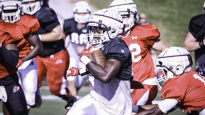 Gardner-Webb running back Narii Gaither breaks the tackle of a defensive teammate during Saturday's scrimmage at Spangler Stadium in Boiling Springs.