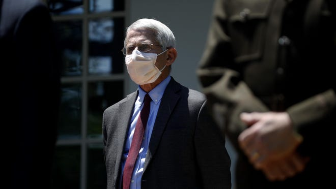 Director of the National Institute of Allergy and Infectious Diseases Dr. Anthony Fauci listens as President Donald Trump speaks about the coronavirus in the Rose Garden of the White House, Friday, May 15, 2020, in Washington.