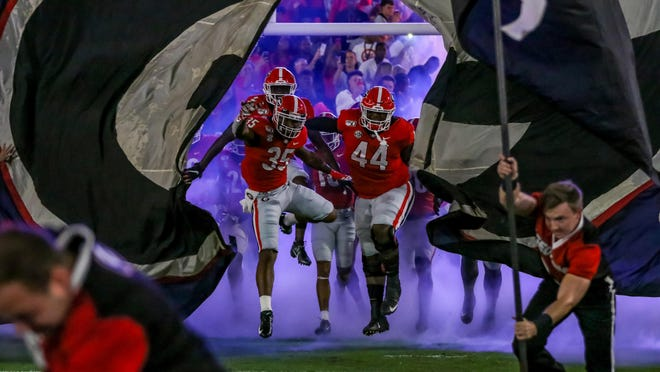 Georgia takes the field before the first half of a NCAA football game between Georgia and Notre Dame in Athens, Ga., on Saturday, Sept. 21, 2019.
