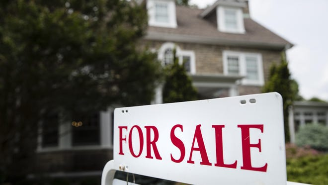 A for sale sign stands in front of a house, in Jenkintown, Pa., Friday, June 8, 2018.