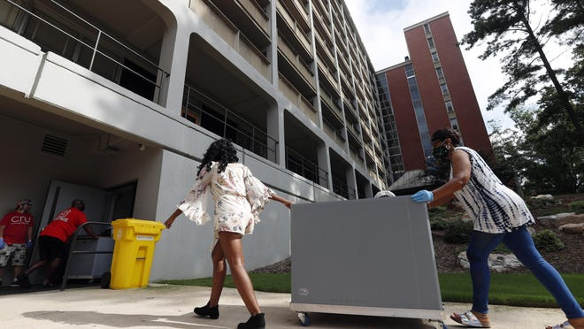 College students begin moving in for the fall semester at N.C. State University in Raleigh July 31. Move-ins are staggered throughout the day and over multiple days as safety protocols due to the coronavirus are in place.