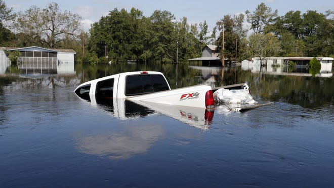 A submerged truck sits in floodwaters in the aftermath of Hurricane Florence on Sept. 21, 2018, in Nichols, S.C. Nichols suffered devastating flooding during Hurricane Matthew 2016 and Florence in 2018.