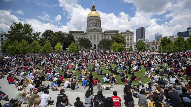 "Hundreds of participants of the ""OneRace Movement"" listen to leaders inside Liberty Plaza, across the street form the Georgia State Capitol building, as they call for a biblical response of justice in Atlanta, Friday, June 19, 2020. The group marched from Centennial Olympic Park to the State Capitol building."