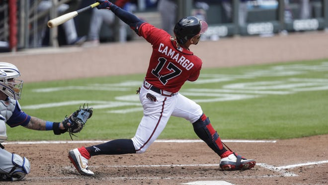 Atlanta's Johan Camargo hits a solo home run in the fifth inning against the New York Mets Sunday, Aug. 2, 2020, in Atlanta.
